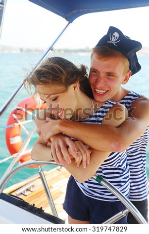 couple in love pirates at the helm - stock photo