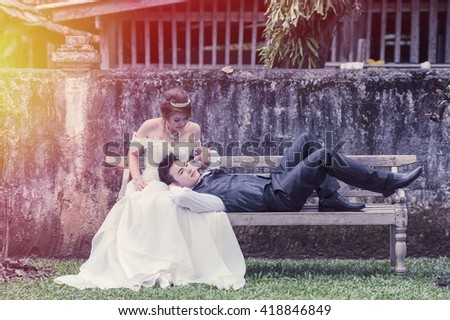 couple in love. portrait of asia young stylish fashion couple posing on outdoor. wedding style, flare and vintage effect - stock photo