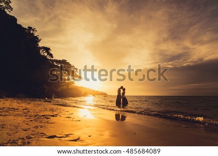 couple in love posing in sunset, outdoor portrait