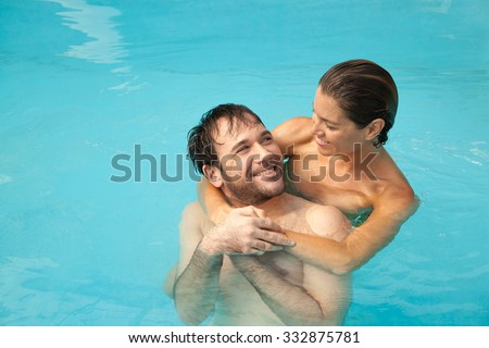 Couple in love relaxing in the pool