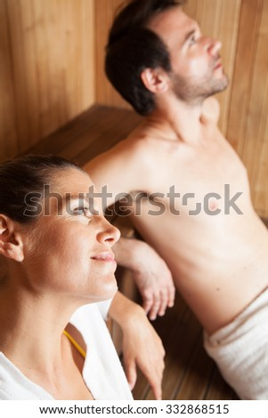 Couple in love relaxing in the sauna - stock photo