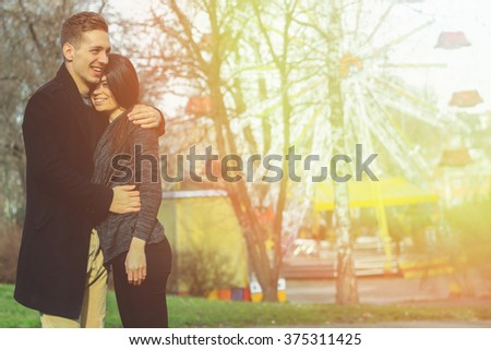 Couple in love smilling - stock photo