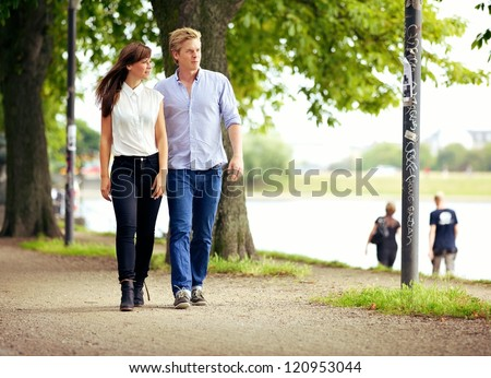 Couple in love strolling together in a beautiful park
