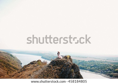 Couple in love surrounded by beautiful landscape