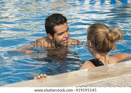 Couple In Love Swimming In The Pool