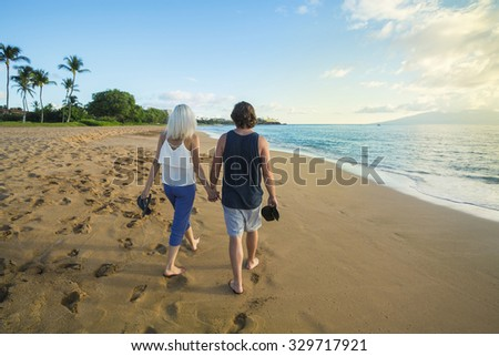 Couple in love walking along the beach together in Maui, Hawaii - stock photo
