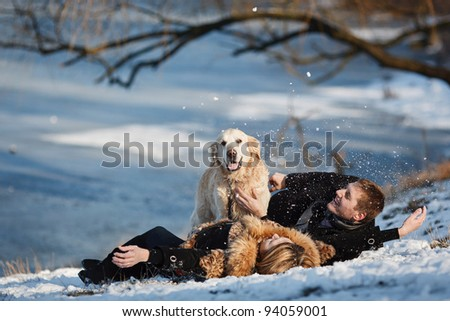 couple in love with a dog - stock photo