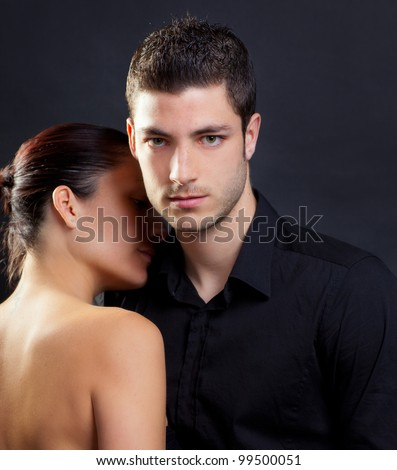 Couple in love with handsome man and rear profile woman nude back - stock photo