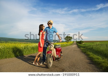Couple in love with motorbike - stock photo