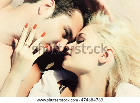 Couple in love. Young man and woman lying facing each other