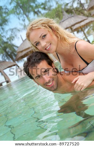 Couple in luxury hotel swimming-pool