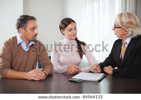 Couple in meeting with a financial planner - stock photo