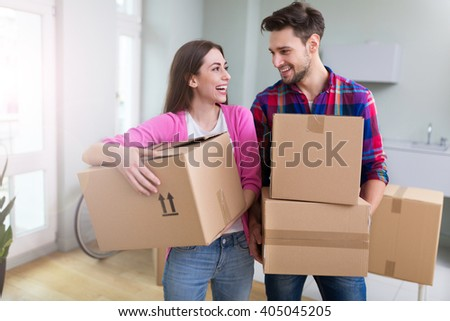 Couple in new flat - stock photo