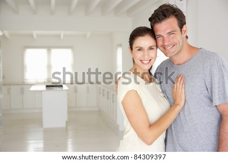 Couple in new home - stock photo