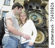 couple in Prague, Horloge, Old Town Hall, Czech Republic - stock photo