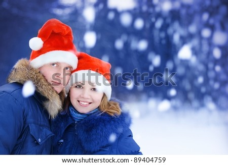 couple in red christmas hat - stock photo