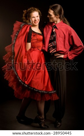 Couple in red dance costumes - stock photo