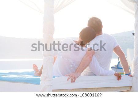 Couple in romantic hug at the sea - stock photo