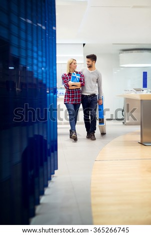 Couple in shopping at TV store. Shallow depth of field. - stock photo