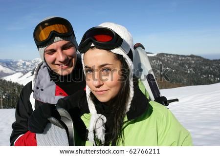 Couple in snowy landscape - stock photo