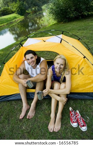 Couple in tent - stock photo