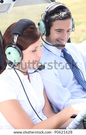 Couple in the cockpit of a light aircraft - stock photo
