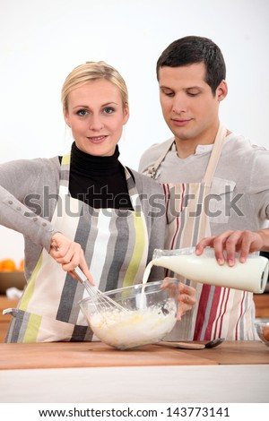 Couple in the kitchen baking - stock photo