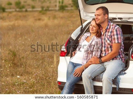 couple in the mountains by car