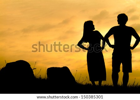 Couple in the rock field silhouette