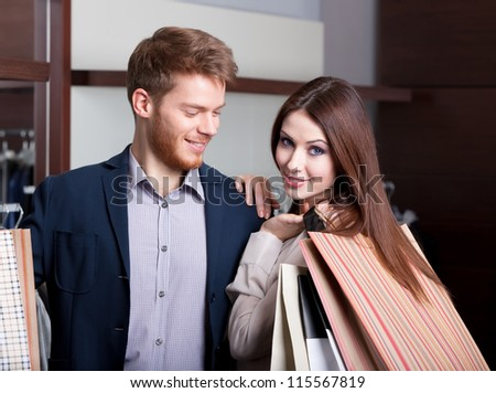 Couple in the shop admires each other - stock photo