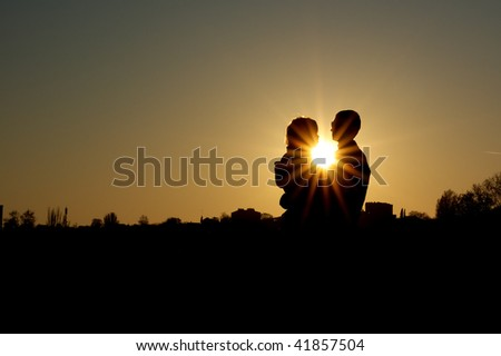Couple in the sunset. Romantic scene.