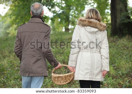 Couple in the woods - stock photo