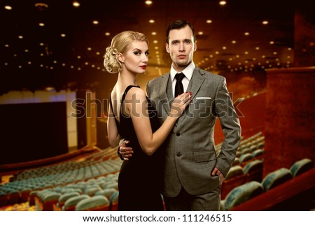 Couple in theatre interior - stock photo