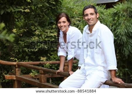 couple in their garden - stock photo