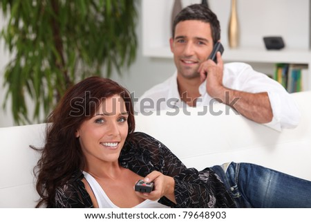 couple in their lounge - stock photo