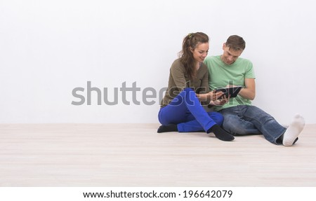 Couple in their new home - stock photo