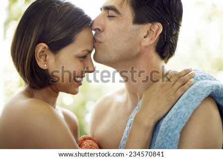 Couple in Towels Kissing - stock photo