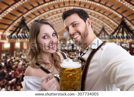 Couple in traditional bavarian costume in Germany - stock photo