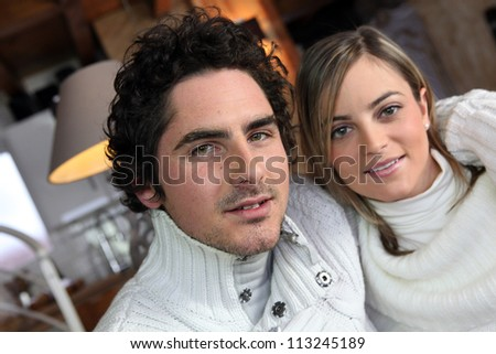 Couple in winter sweaters