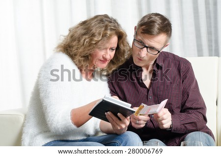 couple is calculating lottery win - stock photo