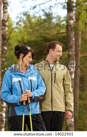 Couple is hiking in mountains