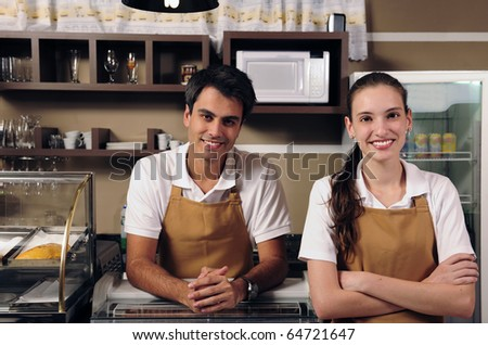 Couple is owner of a cafe or waitress and waiter working - stock photo