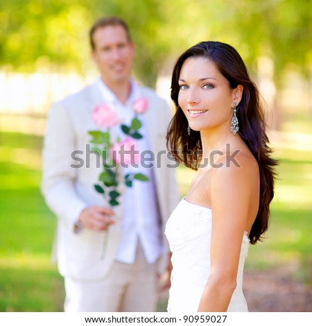 couple just married with man holding flowers in hand - stock photo