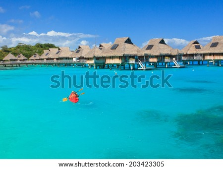 Couple kayaking in the blue lagoon, Bora Bora, French Polynesia, South Pacific  - stock photo