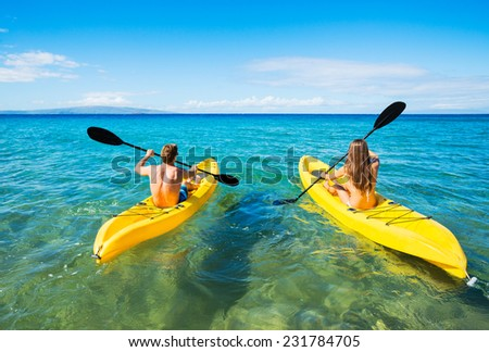 Couple Kayaking in the Ocean on Vacation  - stock photo