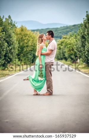 Couple kissing at alley in city - stock photo