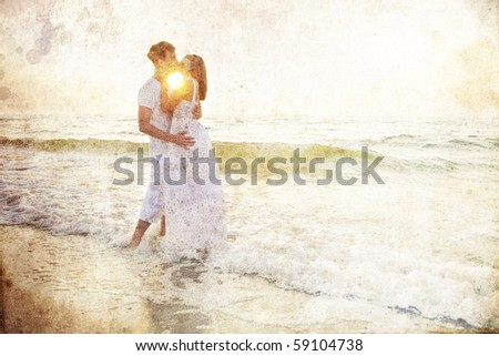 Couple kissing at sunrise. Photo in old colour image style. - stock photo