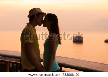 Couple kissing by the sea.  - stock photo