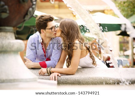 Couple kissing happiness fun - stock photo