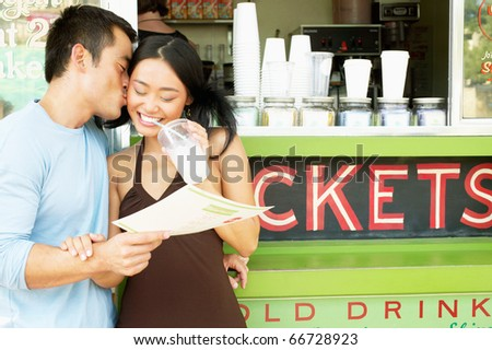 Couple kissing in front of coffee bar